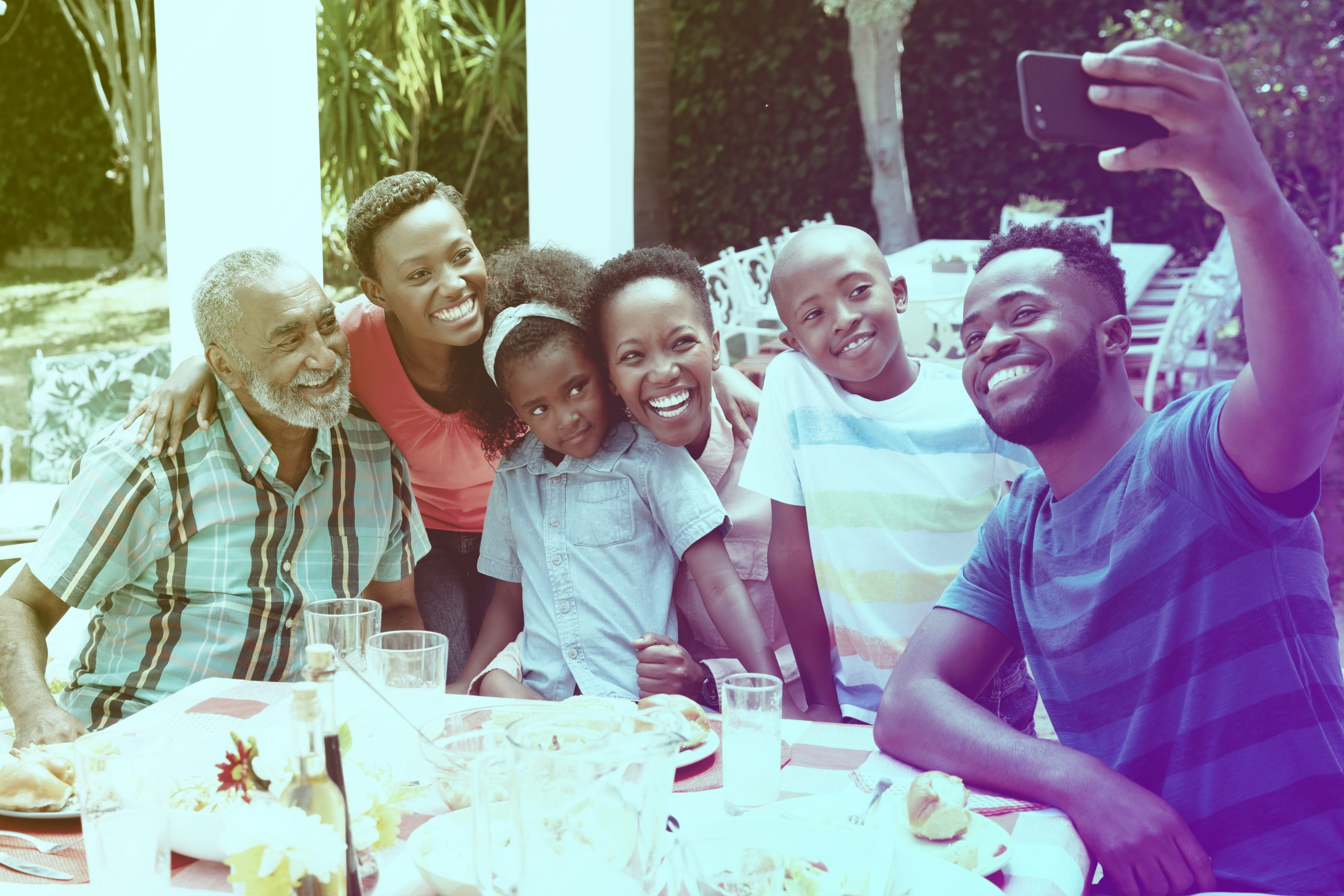 Tobagonian-family-taking-a-selfie-in-the-gar-UH867X3